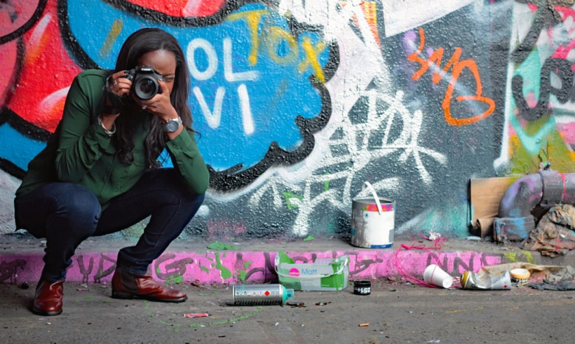 Me stooping graffiti tunnel