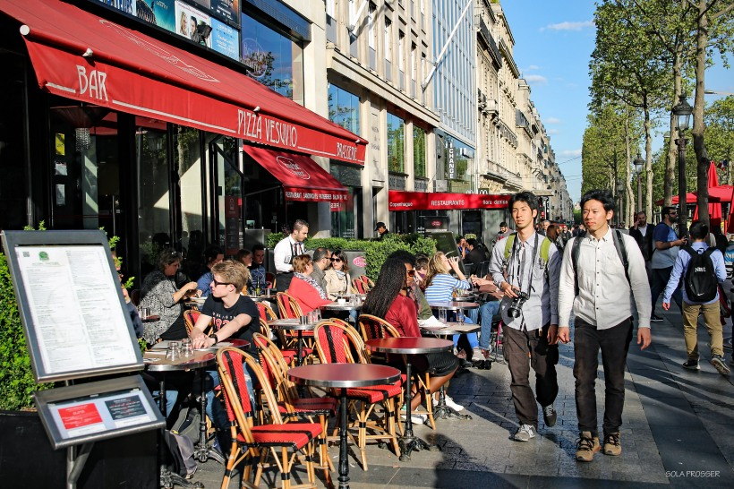 Living like a Parisian. The colourful exterior of this typical café just lures you in.