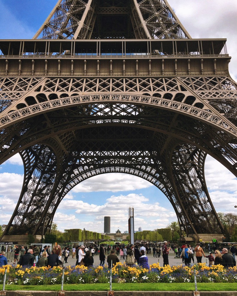 The Eiffel Tower is a wrought iron lattice tower on the Champ de Mars in Paris. It has become become one of the most enduring symbols of France.